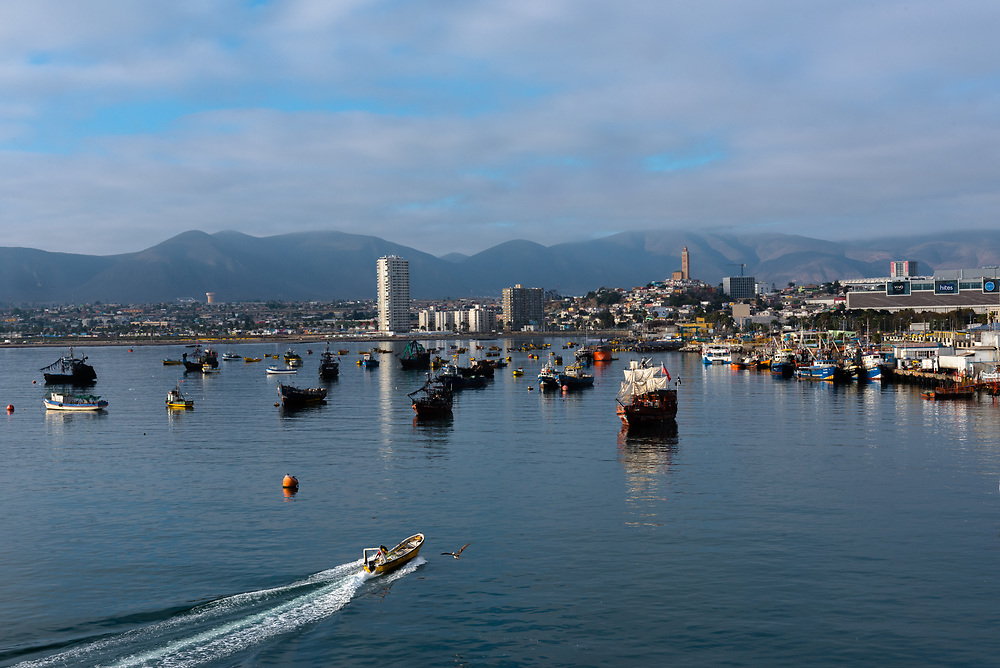 Coquimbo, Chile--April 7, 2018. Small boats lie at anchor in Coquimbo harbor. Foothills of the Andes are in the distance. Editorial Use Only.