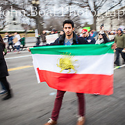"Cyrus Trajano, holding the old Persian flag, with the Lion and Sun, emblems of Iran's flag from 1846 until 1980, during a protest of the executive order issued by President Trump on January 26, 2017, banning refugees, migrants and foreign nationals from seven majority Muslim nations from entering the United States.  Trajano, whose parents are from Iran, traveled from Philadelphia to participate in the demonstration.  When he was asked about his hopes for the next four years, he simply said ""perseverance"".  Many of the protestors saw it as targeted effort to restrict Muslim immigrants.  The effect of the executive order was that many airports were thrown into confusion as many US residents with green cards were detained at airports upon attempting to reenter the United States.  John Boal Photography"