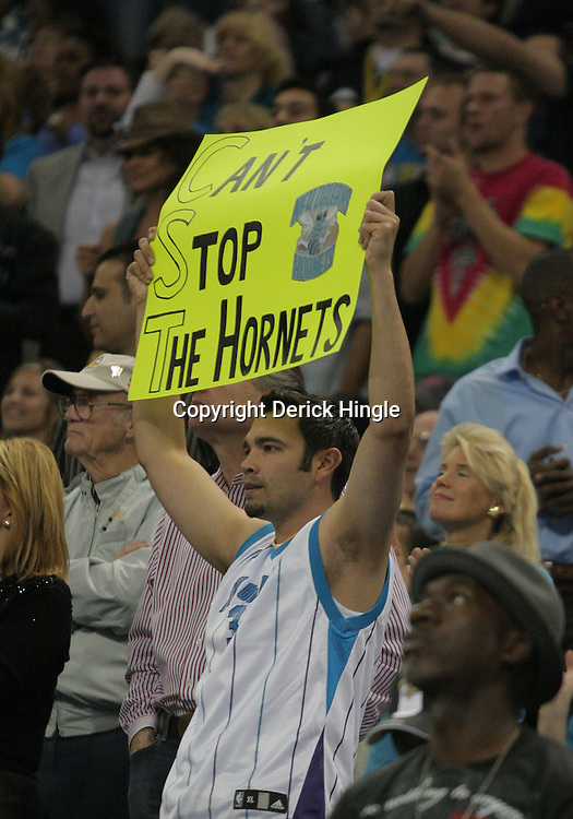 07 March 2009: A New Orleans Hornets fan cheers from the stands during a 108-90 win by the New Orleans Hornets over the Oklahoma City Thunder at the New Orleans Arena in New Orleans, Louisiana.