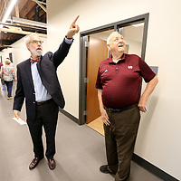 Architect Gary Shafer, with Shafer Zahner Zahner Office of Architecture in Starkville, points out details of the building to Charles Weatherly, of Starkville, as they tour the office area of the renovated Starkville Police Department during the grand opening ceremony Friday morning in Starkville.