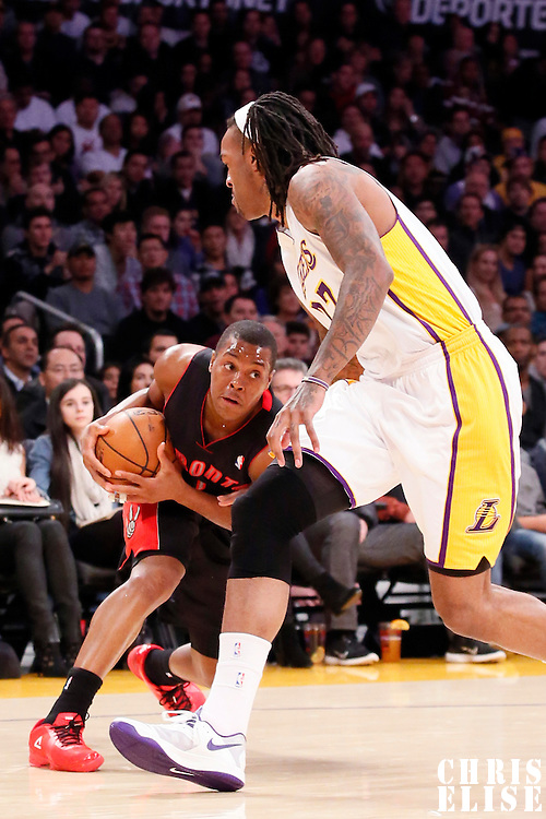 08 December 2013: Los Angeles Lakers center Jordan Hill (27) defends on Toronto Raptors point guard Kyle Lowry (7) during the Toronto Raptors 106-94 victory over the Los Angeles Lakers at the Staples Center, Los Angeles, California, USA.