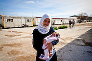 Syria refugees of name Rim, 21 years old ,with daughter named Maria was born 20 days ago in Athens, guest of the Temporary accommodation center for immigrants in Eleonas of Athens, 11 Febraury 2016.<br /> The reception center in Eleonas of Athens, with a capacity of 720 persons, was opened in August 2015.