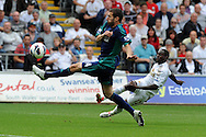 Swansea city's Nathan Dyer ® has a shot at goal blocked by Sunderland's Carlos Cuellar. Barclays Premier league, Swansea city v Sunderland at the Liberty Stadium in Swansea, South Wales on Saturday 1st Sept 2012. pic by Andrew Orchard, Andrew Orchard sports photography,