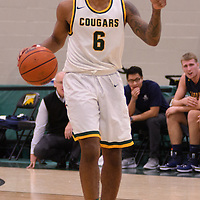 5th year guard Matthew Augustine (6) of the Regina Cougars in action during the home opener  on November  4 at Centre for Kinesiology, Health and Sport. Credit: /Arthur Images