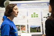 """Meghan Little receives graduate student award for her work titled, """"Conservation and Compliance: A Case Study in Kosovo's Bjeshket e Nemuna National Park"""" from Janet Hulm, Interim Dean of University Libraries at the Student Expo. Photo by Ben Siegel"""