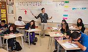 Albert Wei teaches a 12th grade economics class at Sharpstown High School, May 17, 2013.