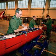 Ground crew members the 'Red Arrows', Britain's Royal Air Force aerobatic team maintain a smoke pod belonging Hawk.