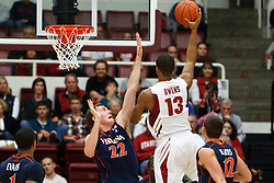 November 18, 2010; Stanford, CA, USA;  Stanford Cardinal forward/center Josh Owens (13) shoots over Virginia Cavaliers forward Will Sherrill (22) during the second half at Maples Pavilion.  Stanford defeated Virginia 81-60.
