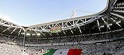 &copy; Filippo Alfero<br /> Juventus-Cagliari, Serie A 2014/2015<br /> Torino, 09/05/2015<br /> sport calcio<br /> Nella foto: la curva dei tifosi della Juve, al centro il tricolore, bandiera italiana