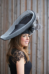 LIVERPOOL, ENGLAND - Friday, April 4, 2014: Sally Evans of Liverpool wearing a hat by Jessica Beak during Ladies' Day on Day Two of the Aintree Grand National Festival at Aintree Racecourse. (Pic by David Rawcliffe/Propaganda)