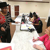 """Jennifer Jones known as a """"Community Angel"""" sings a song to Sandra Robertson, a receptionist at, and the other office workers at Cook's Adult Day Care in New Albany."""