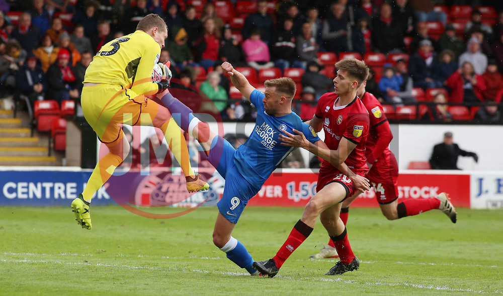 Matt Godden of Peterborough United challenges for the ball with Chris Dunn of Walsall - Mandatory by-line: Joe Dent/JMP - 27/04/2019 - FOOTBALL - Banks's Stadium - Walsall, England - Walsall v Peterborough United - Sky Bet League One