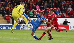 Matt Godden of Peterborough United challenges for the ball with Chris Dunn of Walsall - Mandatory by-line: Joe Dent/JMP - 27/04/2019 - FOOTBALL - Banks's Stadium - Walsall, England - Walsall v Peterborough United - Sky Bet League One