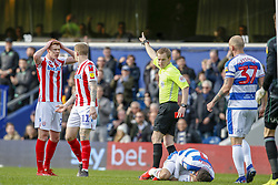 March 9, 2019 - London, England, United Kingdom - Referee Gavin Ward shows a straight red card to, and sends off Stoke City's Sam Clucas after he stamps on Queens Park Rangers Josh Scowen during the first half of the Sky Bet Championship match between Queens Park Rangers and Stoke City at Loftus Road Stadium, London on Saturday 9th March 2019. (Credit Image: © Mi News/NurPhoto via ZUMA Press)