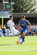 Will Nightingale of AFC Wimbledon and Mawouna Amevor battle during the Sky Bet League 2 match between AFC Wimbledon and Notts County at the Cherry Red Records Stadium, Kingston, England on 19 September 2015. Photo by Stuart Butcher.