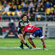 Peter Umaga-Jensen tackled by Filipo Daugunu during the Super rugby union game (Round 14) played between Hurricanes v Reds, on 18 May 2018, at Westpac Stadium, Wellington, New  Zealand.    Hurricanes won 38-34.
