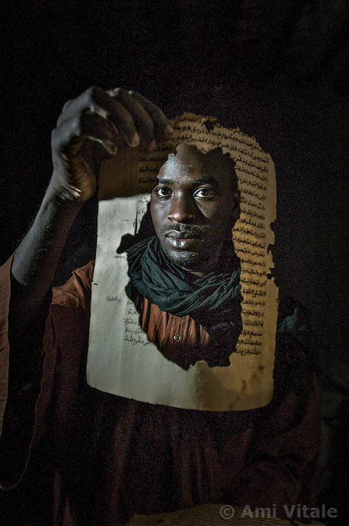 Boubacar Sadeck, the last caligrapher in Timbuktu, Mali holds ancient manuscripts that his family owns in his home  After Islamic militants launched a campaign to eradicate historic vestiges of a medieval Muslim civilization that they deemed un-Islamic, international scholars feared the worst: that  the militants had torched the Ahmed Baba Institute, home to 30,000 priceless items of scholarship dating back to the 13th century...But many volumes may have escaped destruction by being hidden from fundamentalist forces that seized the north last year.  ..  (Photo by Ami Vitale)