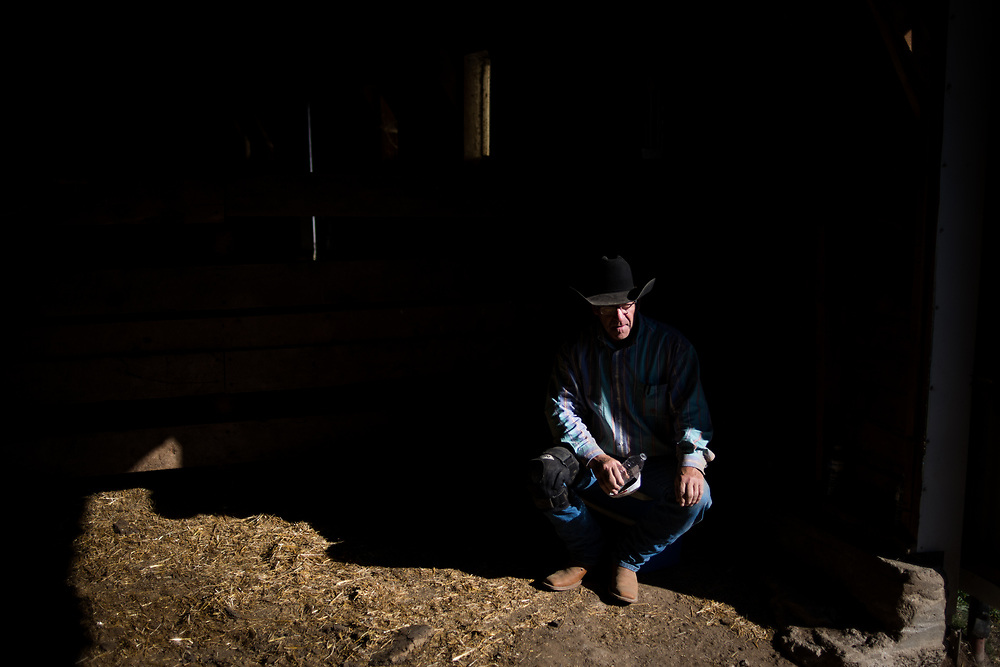Randy Hapney takes a break while doing chiropractic work on a ranch on the old abandoned town of Chance, SD on October 5, 2017. Equine chiropractic work was generally looked at with suspicion for years but more ranchers have begun to use their services to fix issues with horses to keep them healthy and working longer.