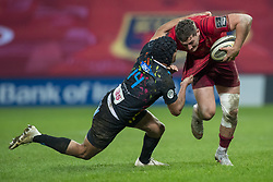 March 23, 2019 - Limerick, Ireland - Dan Goggin of Munster tackled by Gabriele Di Giulio of Zebre during the Guinness PRO14 match between Munster Rugby and Zebre at Thomond Park Stadium in Limerick, Ireland on March 23, 2019  (Credit Image: © Andrew Surma/NurPhoto via ZUMA Press)