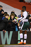Barnsley's Mamadou Thiam (26) passes his shirt to a Barnsley supporter during the EFL Sky Bet Championship match between Nottingham Forest and Barnsley at the City Ground, Nottingham, England on 24 April 2018. Picture by Jon Hobley.