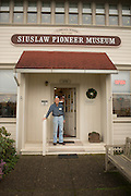 Fred Jensen, a Florence native, welcomes people to the Siuslaw Pioneer Museum.