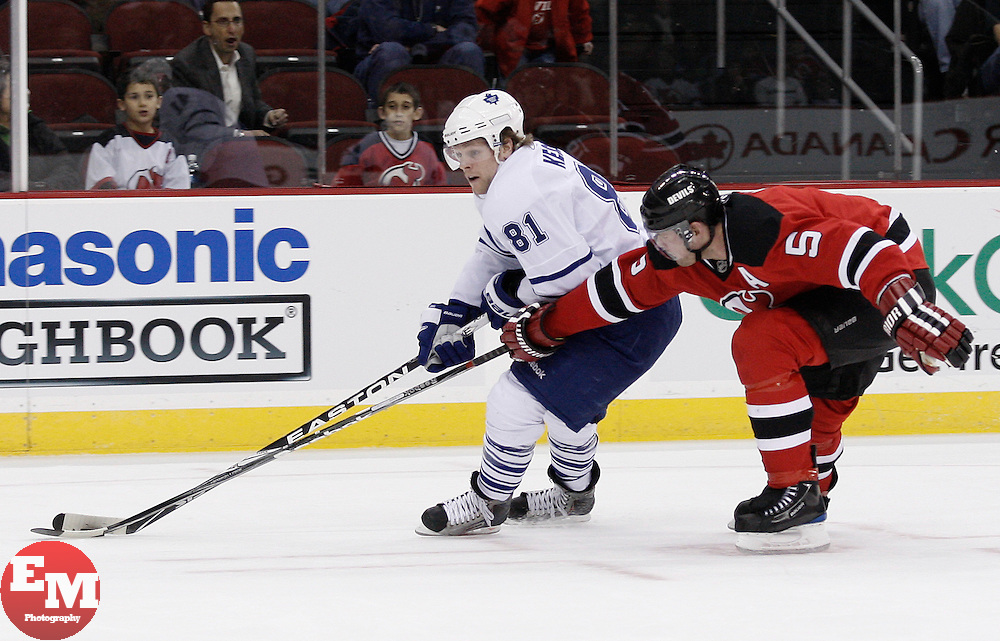 Jan 29, 2010; Newark, NJ, USA; Toronto Maple Leafs right wing Phil Kessel (81) skates with the puck by New Jersey Devils defenseman Colin White (5) during the first period at the Prudential Center.