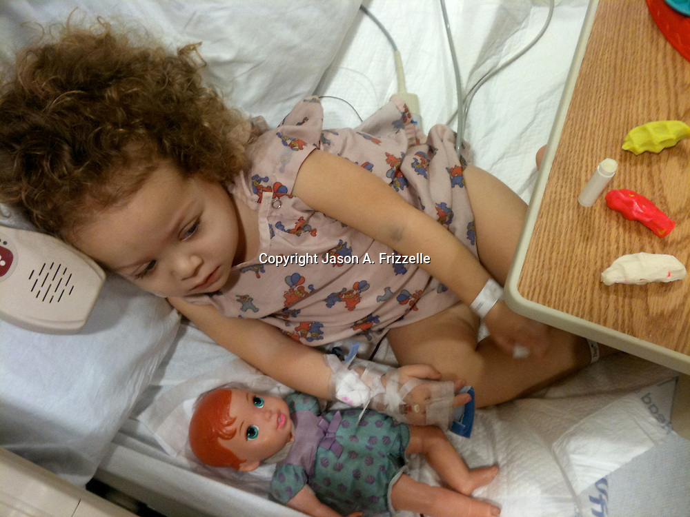 On December 27, 2012 two year old Holly Larue Frizzelle was diagnosed with Acute Lymphoblastic Leukemia. What began as a stomach ache and visit to her regular pediatrician led to a hospital admission, transport to the University of North Carolina Children's Hospital, and more than two years of treatment. Holly Larue Frizzelle has a blood transfusion in her room at UNC Hospital in December 2012.