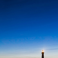Crescent moon over Cape Hatteras Lighthouse