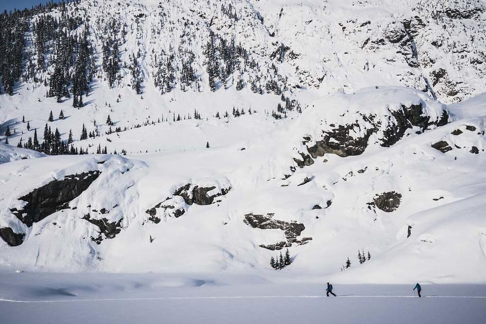 Josh Breau and Emily Bodner skinning the flats, Howson Range, British Columbia.