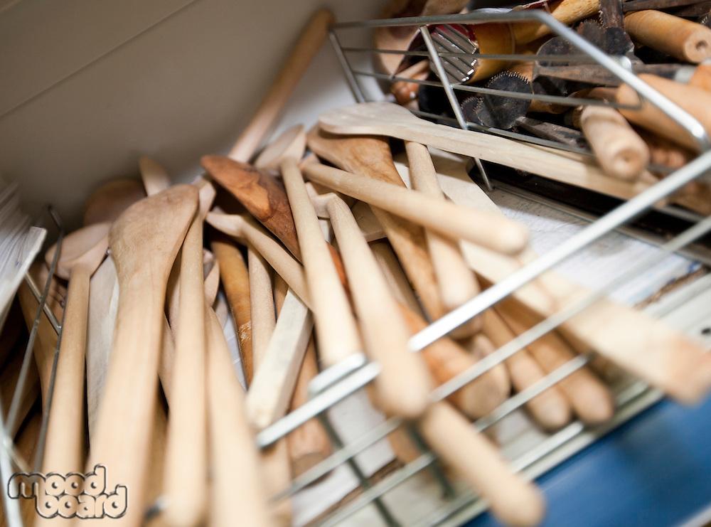 Wooden spatulas on shelf in utlensil store