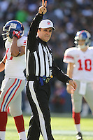 SEATTLE - NOVEMBER 7: One of the referees during the game between the New York Giants and theSeattle Seahawks at Qwest Field on November 7, 2010 in Seattle, Washington. The Giants defeated the Seahawks 41-7.(Photo by Tom Hauck) Player: