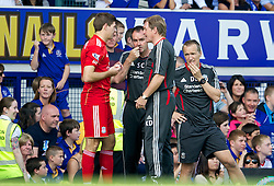 LIVERPOOL, ENGLAND - Saturday, October 1, 2011: Liverpool's manager Kenny Dalglish and assistant manager Steve Clarke prepare to bring on substitute captain Steven Gerrard MBE against Everton during the Premiership match at Goodison Park. (Pic by David Rawcliffe/Propaganda)
