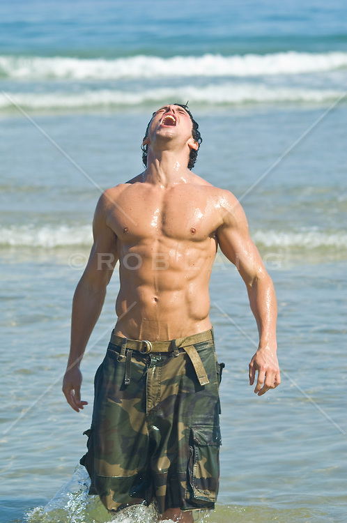 Very Good looking fit man in the Atlantic Ocean In Montauk, NY enjoying the sun
