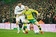 Norwich City midfielder Kenny McLean (23) shields the ball during the EFL Sky Bet Championship match between Norwich City and Swansea City at Carrow Road, Norwich, England on 8 March 2019.