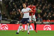Harry Kane of Tottenham Hotspur battles with Manchester United Defender Chris Smalling during the Premier League match between Tottenham Hotspur and Manchester United at Wembley Stadium, London, England on 31 January 2018. Photo by Phil Duncan.