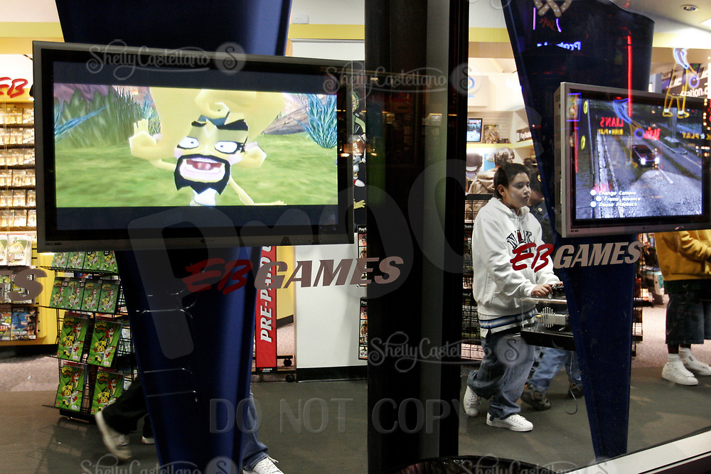 Jan 15, 2005; Hollywood, CA, USA; Visitor plays a video game inside the EB Games store on the City Walk at Universal Studios Theme Park in Hollywood.   Mandatory Credit: Photo by Shelly Castellano/ZUMA Press.