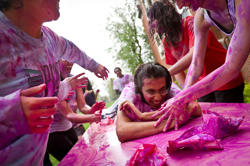 Raghav Malik '13 reacts to being covered in colors during the Holi Festival of Colors at Grinnell College on Saturday. The holiday is noted for participants throwing powdered colors and water at each other and serves to mark the beginning of the spring season.<br /> <br /> BEN BREWER/Grinnell College