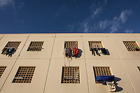LECCE, ITALY - 10 NOVEMBER 2016: Clothes of female inmates hang from the windows of their prison cells in the largest penitentiary in the southern Italian region of Apulia, holding 1,004 inmates in the outskirts of Lecce, Italy, on November 10th 2016.<br /> <br /> Here a group of ten high-security female inmates and aspiring sommeliers , some of which are married to mafia mobsters or have been convicted for criminal association (crimes carrying up to to decades of jail time), are taking a course of eight lessons to learn how to taste, choose and serve local wines.<br /> <br /> The classes are part of a wide-ranging educational program to teach inmates new professional skills, as well as help them develop a bond with the region they live in.<br /> <br /> Since the 1970s, Italian norms have been providing for reeducation and a personalized approach to detention. However, the lack of funds to rehabilitate inmates, alongside the chronic overcrowding of Italian prisons, have created a reality of thousands of incarcerated men and women with little to do all day long. Especially those with a serious criminal record, experts said, need dedicated therapy and professionals who can help them.