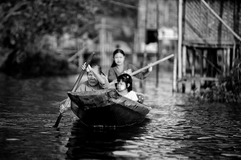 A family leaving home on Inle lake, Myanmar.