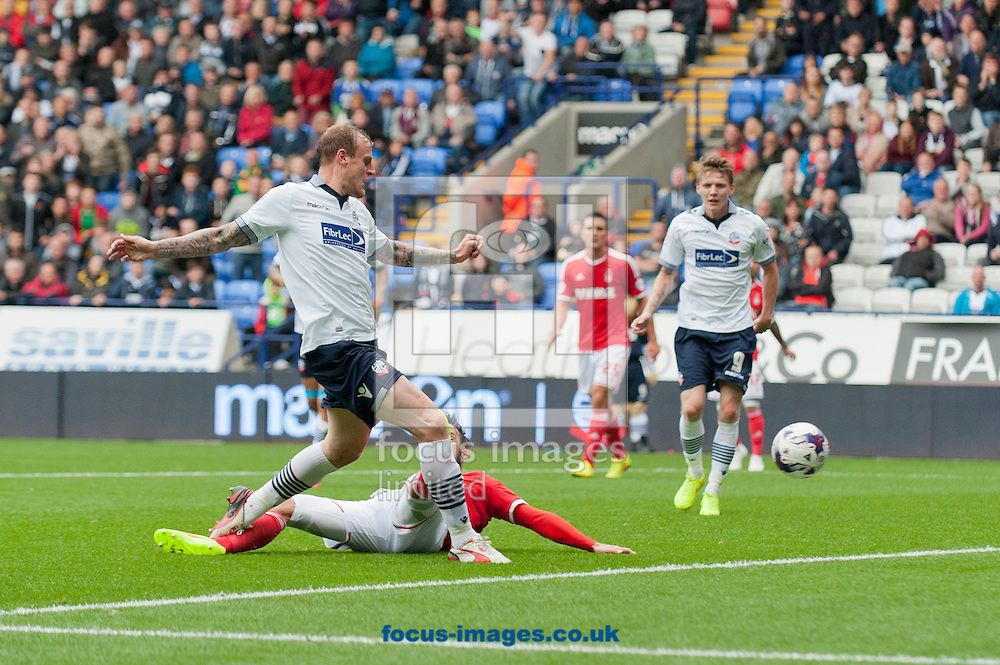 David Wheater of Bolton Wanderers scores his team's 2nd goal to make it 2-1 to the home team during the Sky Bet Championship match at the Macron Stadium, Bolton<br /> Picture by Russell Hart/Focus Images Ltd 07791 688 420<br /> 16/08/2014