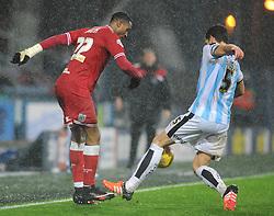 Jonathan Kodjia of Bristol City is tackled by Mark Hudson of Huddersfield Town - Mandatory byline: Dougie Allward/JMP - 12/12/2015 - Football - St John Smith's Stadium - Huddersfield, England - Huddersfield Town v Bristol City - Sky Bet Championship