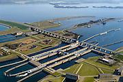 Nederland, Zeeland, Gemeente Schouwen-Duiveland, 01-04-2016; Philipsdam en Krammersluizen. Onderdeel van het compartimenteringswerk waardoor het zoete water van Volkerak (rechtsboven) en het zoute water van het Krammer gescheiden blijft. In de voorgrond de bedieningsgebouwen voor het zoet-zoutscheidingssysteem van de sluizen, de doorlaatwerken.<br /> Het geheel maakt deel uit maken van de Deltawerken.<br /> Philipsdam with Krammersluizen, part of the Delta Works. The locks form a division between sweet and salt water.<br /> <br /> <br /> luchtfoto (toeslag op standard tarieven);<br /> aerial photo (additional fee required);<br /> copyright foto/photo Siebe Swart