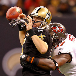 January 2, 2011; New Orleans, LA, USA; New Orleans Saints quarterback Drew Brees (9) is hit by Tampa Bay Buccaneers defensive end Alex Magee (97) causing a fumble during the third quarter at the Louisiana Superdome. Mandatory Credit: Derick E. Hingle
