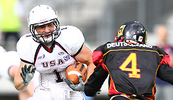 10.07.2011, Tivoli Stadion, Innsbruck, AUT, American Football WM 2011, Group A, Germany (GER) vs United States of America (USA), im Bild Roman Solovij (Germany, #4, DB) tries to block Nate Kmic (USA, #1, RB)  // during the American Football World Championship 2011 Group A game, Germany vs USA, at Tivoli Stadion, Innsbruck, 2011-07-10, EXPA Pictures © 2011, PhotoCredit: EXPA/ T. Haumer