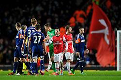 Arsenal Midfielder Santi Cazorla (ESP) shakes hands with Fulham Defender Dan Burn (ENG) after Arsenal win the match 2-0 - Photo mandatory by-line: Rogan Thomson/JMP - Tel: Mobile: 07966 386802 - 18/01/14 - SPORT - FOOTBALL - Emirates Stadium - Arsenal v Fulham - Barclays Premier League.