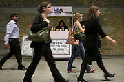 "Striding urgently are a group of rail commuters emerging from London Bridge main line station in central London along a station concourse. Marching in step, the strangers are on their way to work in the City of London or Southwark on the south bank of the Thames. They are all passing-by a mobile smoothie drink kiosk that has the slogan ""Guaranteed to keep you going till lunch."" London Bridge station is one of 18 railway stations managed by Network Rail and is a major transport terminus and interchange for central London and serves over 42 million people a year. The tube station serves the Jubilee Line and the Bank branch of the Northern Line."