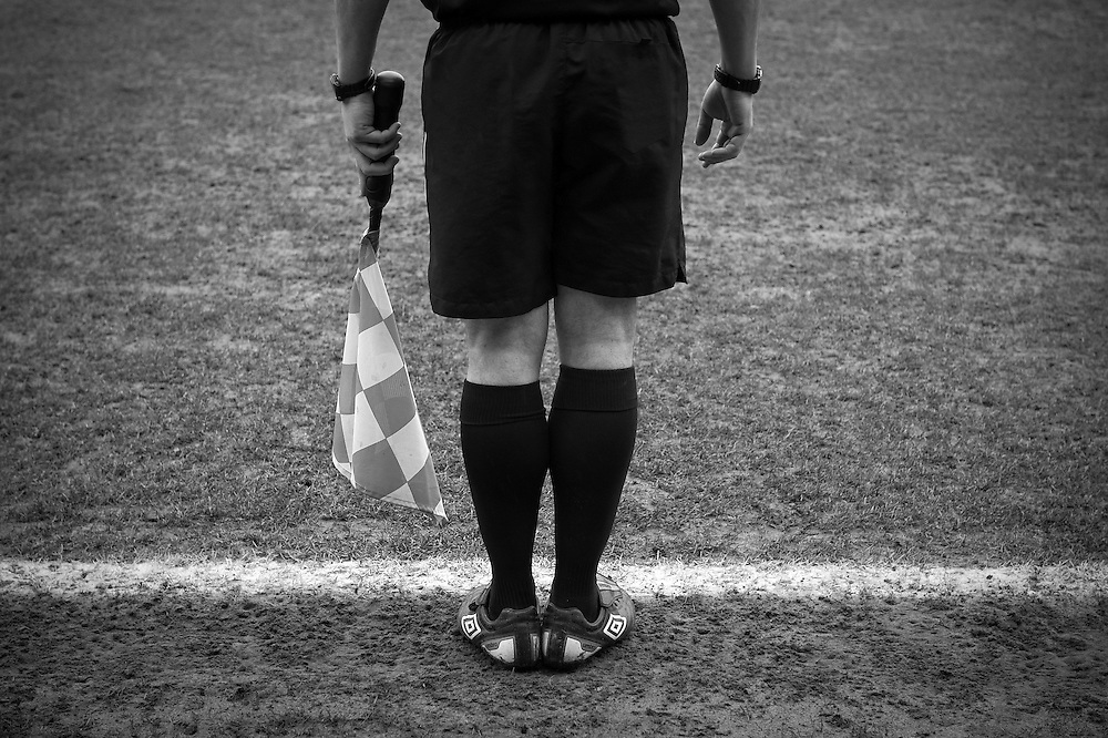 FC United of Manchester play a local team Chorley at Bury football club's ground in Lancashire, Britain. Photo shows a linesman.