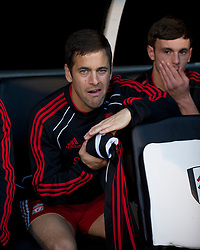 LONDON, ENGLAND - Monday, May 9, 2011: Liverpool's substitute Joe Cole on the bench during the Premiership match against Fulham at Craven Cottage. (Photo by David Rawcliffe/Propaganda)