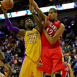 Apr 8, 2016; New Orleans, LA, USA; Los Angeles Lakers center Roy Hibbert (17) shoots over New Orleans Pelicans center Alexis Ajinca (42) during the first quarter of a game at the Smoothie King Center. Mandatory Credit: Derick E. Hingle-USA TODAY Sports