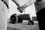 Bill Cox and Linda  Taylor hold hands as they look at a restored Oliver tractor that brings back memories of their youth. They were childhood sweethearts back in the late 40s when Bill courted Linda on an Oliver tractor. They expected to get married until Bill decided to enter the Army. That changed their relationship until this year when they re-met and will get married with a similar Oliver tractor being part of their wedding day.